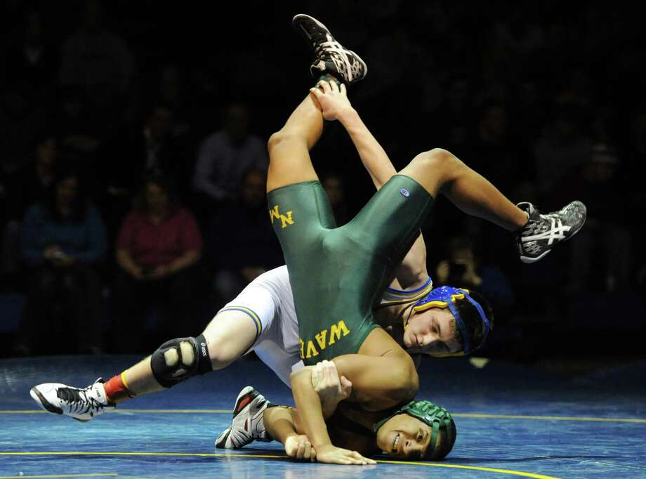 Newtown's Alex Stzbola slams New Milford's Isaiah Jenkins to the mat in the 152 pound match during New Milford's 36-29 win over Newtown at Newtown High School in Newtown, Conn. on Wednesday, Jan. 22, 2014. Photo: Tyler Sizemore / The News-Times
