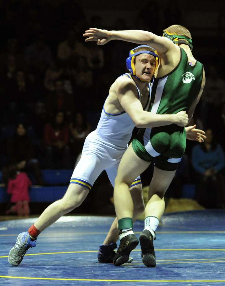Newtown's Mike Long, left, takes down New Milford's Zach Arnold in the 138 pound match during New Milford's 36-29 win over Newtown at Newtown High School in Newtown, Conn. on Wednesday, Jan. 22, 2014. Photo: Tyler Sizemore / The News-Times