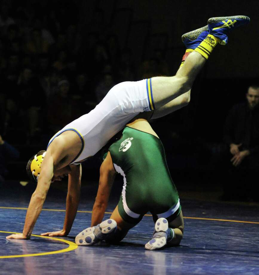 Newtown's James Leuci gets upended by New Milford's Bryan Rojas in the 132 pound match during New Milford's 36-29 win over Newtown at Newtown High School in Newtown, Conn. on Wednesday, Jan. 22, 2014. Photo: Tyler Sizemore / The News-Times