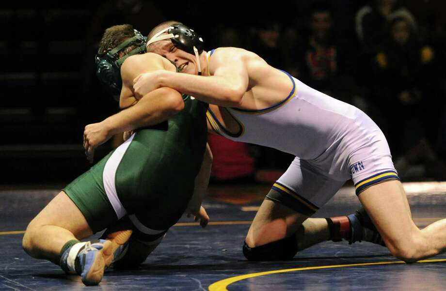 New Milford's Stefan Ceconi, left, wrestles Newtown's Connor Lemay in the 160 pound match during New Milford's 36-29 win over Newtown at Newtown High School in Newtown, Conn. on Wednesday, Jan. 22, 2014. Photo: Tyler Sizemore / The News-Times