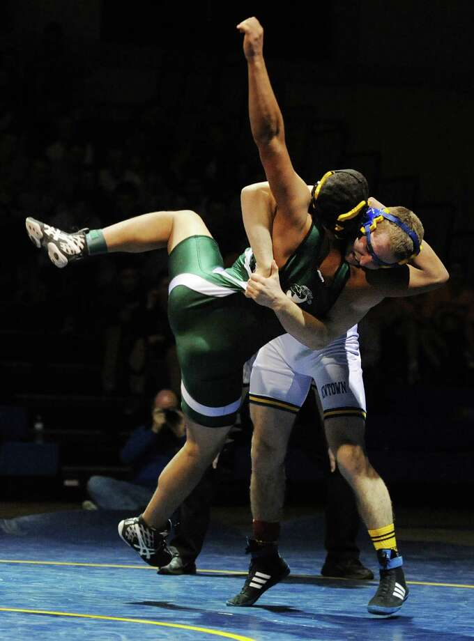 Newtown's Forest Speed slams New Milford's Danny Reyes to the mat in the 171 pound match during New Milford's 36-29 win over Newtown at Newtown High School in Newtown, Conn. on Wednesday, Jan. 22, 2014. Photo: Tyler Sizemore / The News-Times