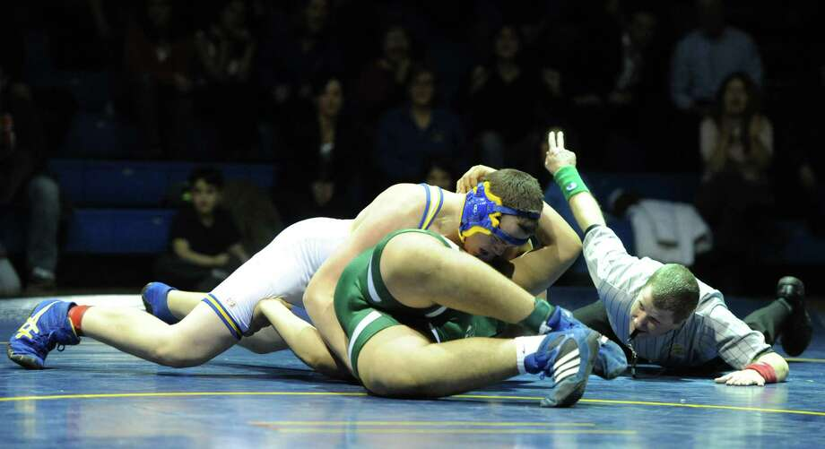 Newtown's Ryan Wagner, top, wrestles New Milford's Jomar Orejuela in the heavyweight match during New Milford's 36-29 win over Newtown at Newtown High School in Newtown, Conn. on Wednesday, Jan. 22, 2014. Photo: Tyler Sizemore / The News-Times