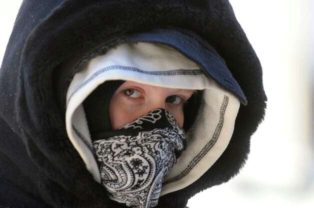 Hannah March of Albany keeps herself covered as she braves the cold temperatures on Wednesday, Jan. 22, 2014, in Albany, N.Y. (Cindy Schultz / Times Union) Photo: Cindy Schultz / 00025459A