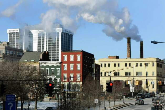 Smokestack fumes hang in the frigid air on Wednesday, Jan. 22, 2014, in Albany, N.Y. (Cindy Schultz / Times Union) Photo: Cindy Schultz / 00025459A