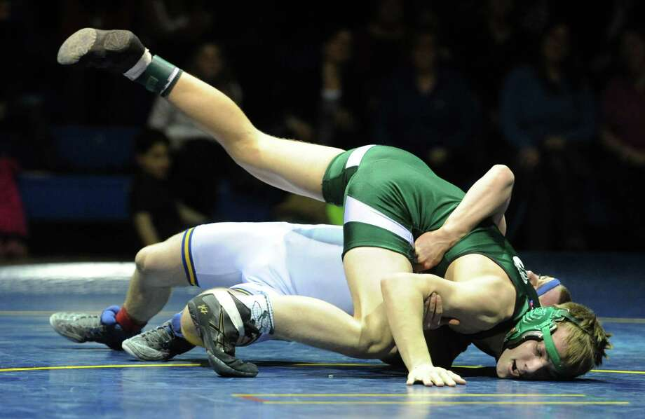 _ wrestles _ in the _ pound match during New Milford's 36-29 win over Newtown at Newtown High School in Newtown, Conn. on Wednesday, Jan. 22, 2014. Photo: Tyler Sizemore / The News-Times