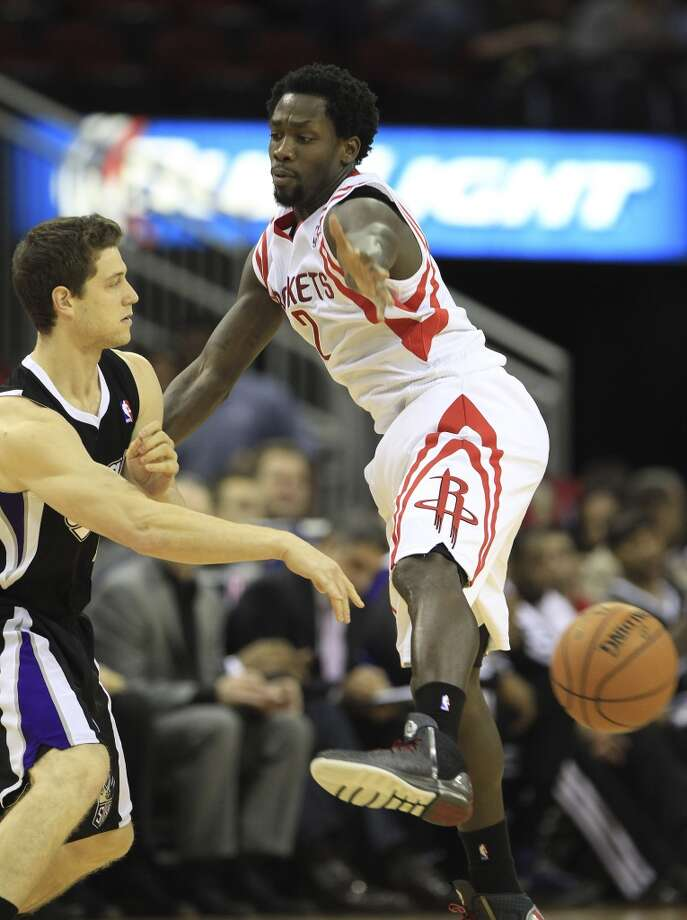 Jan. 22:  Rockets 119, Kings 98  Rockets point guard Patrick Beverley (2) tries to deflect the ball as Kings point guard Jimmer Fredette (7) tries to pass. Photo: Karen Warren, Houston Chronicle