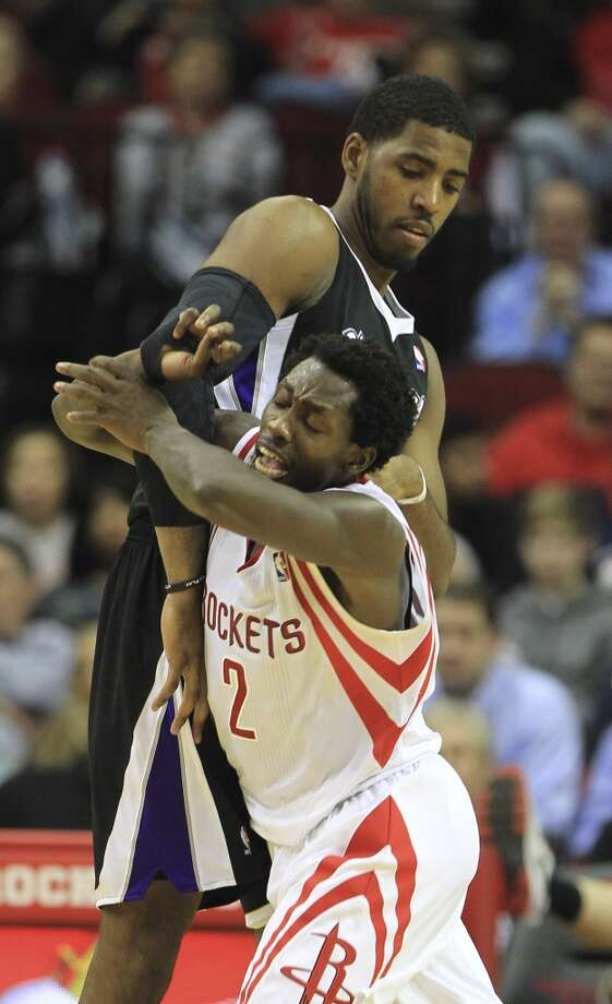 Rockets point guard Patrick Beverley (2) battles against Kings power forward Jason Thompson. Photo: Karen Warren, Houston Chronicle