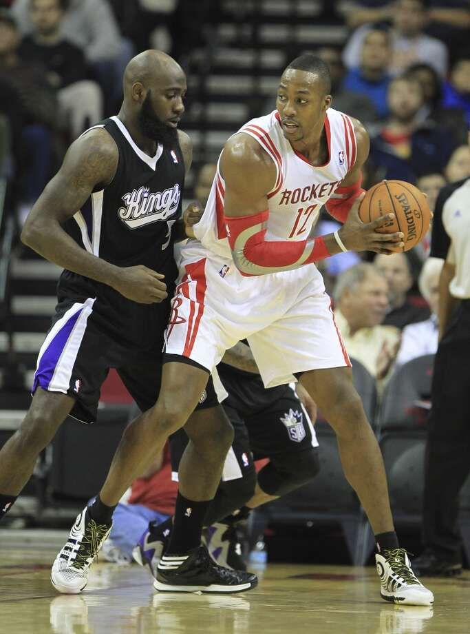 Rockets center Dwight Howard (12) works against the defense of Kings small forward Quincy Acy. Photo: Karen Warren, Houston Chronicle