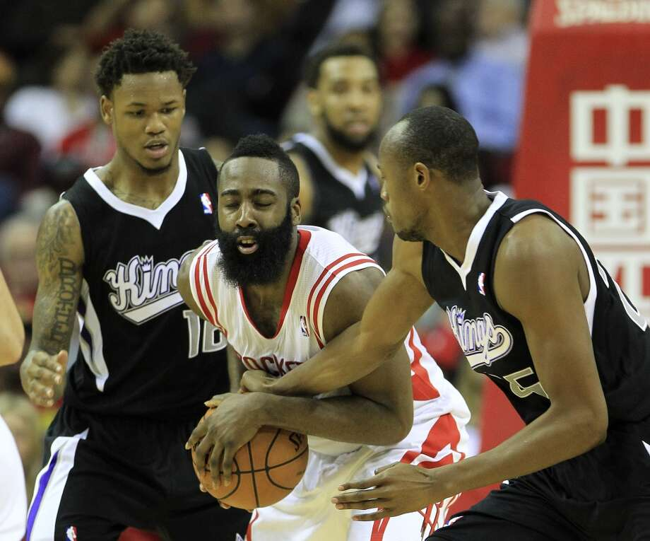 Rockets shooting guard James Harden (13) is caught in the middle of Kings small forward Travis Outlaw (25) and Ben McLemore (16). Photo: Karen Warren, Houston Chronicle