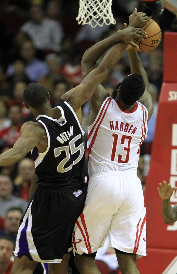 Rockets shooting guard James Harden (13) gets fouled going to the basket by Kings small forward Travis Outlaw. Photo: Karen Warren, Houston Chronicle
