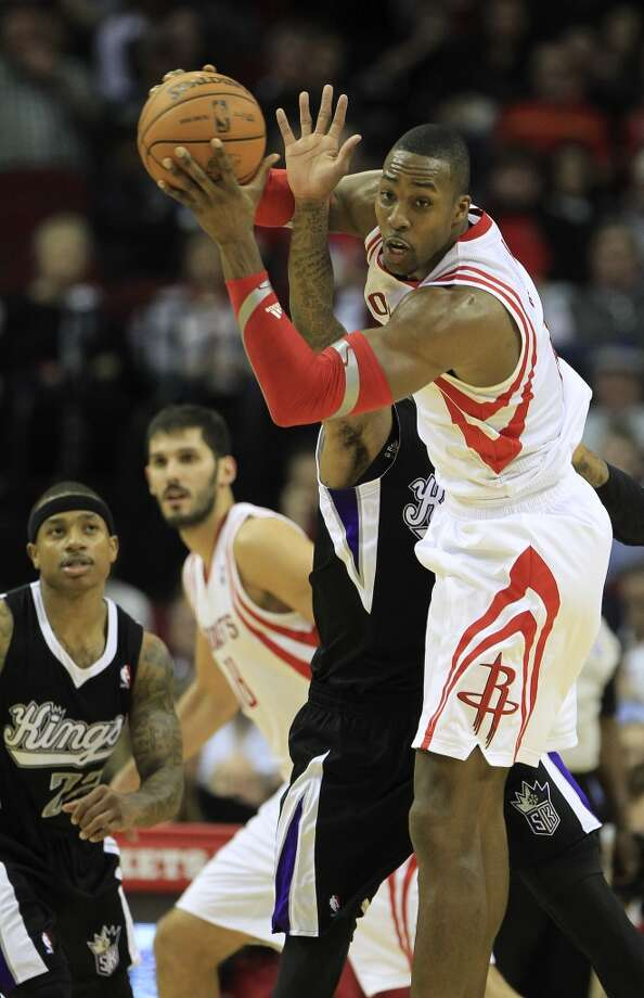 Rockets center Dwight Howard (12) grabs a rebound over Kings shooting guard Ben McLemore. Photo: Karen Warren, Houston Chronicle