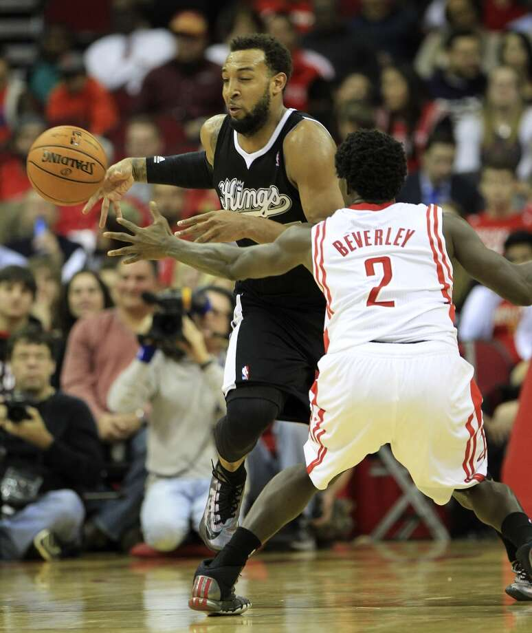 Kings power forward Derrick Williams (13) gets the ball knocked loose by Rockets point guard Patrick Beverley. Photo: Karen Warren, Houston Chronicle