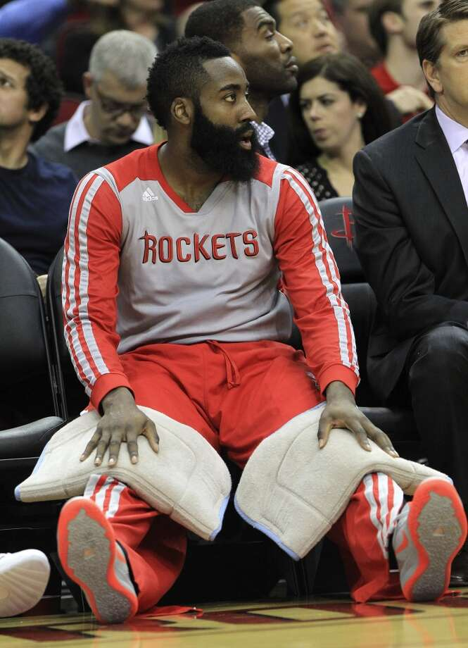 Rockets shooting guard James Harden sits on the bench. Photo: Karen Warren, Houston Chronicle