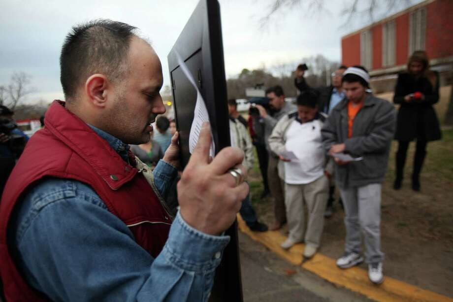 Jose Urdanivia, cousin of Prisoner Edgar Arias Tamayo, prays outside the Texas State Penitentiary 'Walls Unit' for his family member not to be executed for the death of Houston Police Officer Guy P. Gaddis on Wednesday, Jan. 22, 2014, in Huntsville. Photo: Mayra Beltran, Houston Chronicle / © 2013 Houston Chronicle