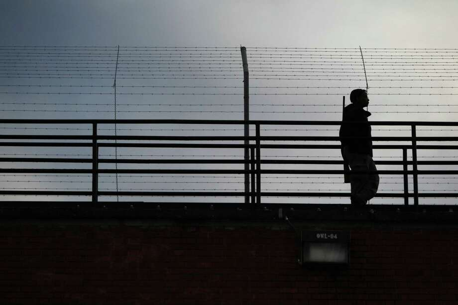 A guard patrols from the tower near where Prisoner Edgar Arias Tamayo is scheduled to be executed at Texas State Penitentiary at 'Walls Unit'  for the death of Houston Police Officer Guy P. Gaddis on Wednesday, Jan. 22, 2014, in Huntsville. Photo: Mayra Beltran, Houston Chronicle / © 2013 Houston Chronicle