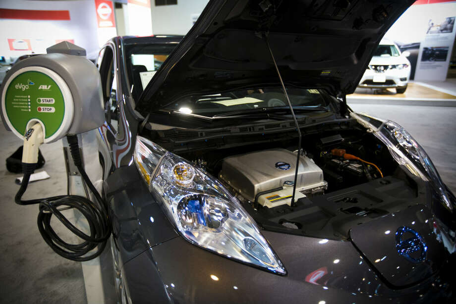 Nissan LEAF Electric Car is displayed at the Houston Auto Show on Tuesday, Jan. 21, 2014. The Nissan LEAF gets the equivalent of about 129 miles per gallon in the city. Photo: Marie D. De Jesus, Houston Chronicle