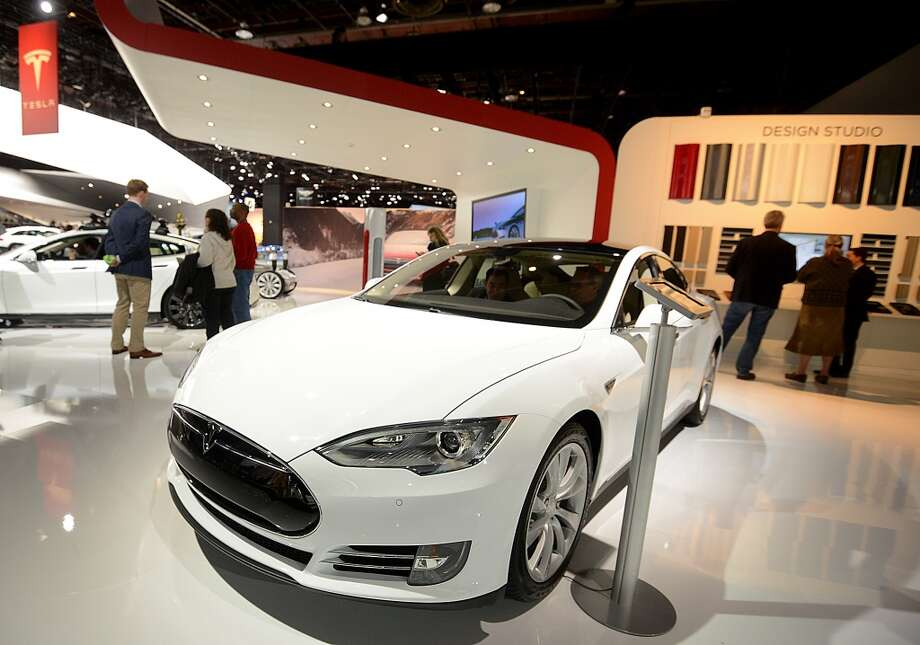 The Tesla Motors Inc. Model S sedan is displayed during the 2014 North American International Auto Show (NAIAS) in Detroit, Michigan, U.S., on Tuesday, Jan. 14, 2014. Tesla Motors Inc., the maker of high-end electric cars, gained the most in six weeks after the carmaker said it delivered 6,900 Model S sedans in the fourth quarter, pushing full-year sales beyond a company target. Photo: Daniel Acker, Bloomberg