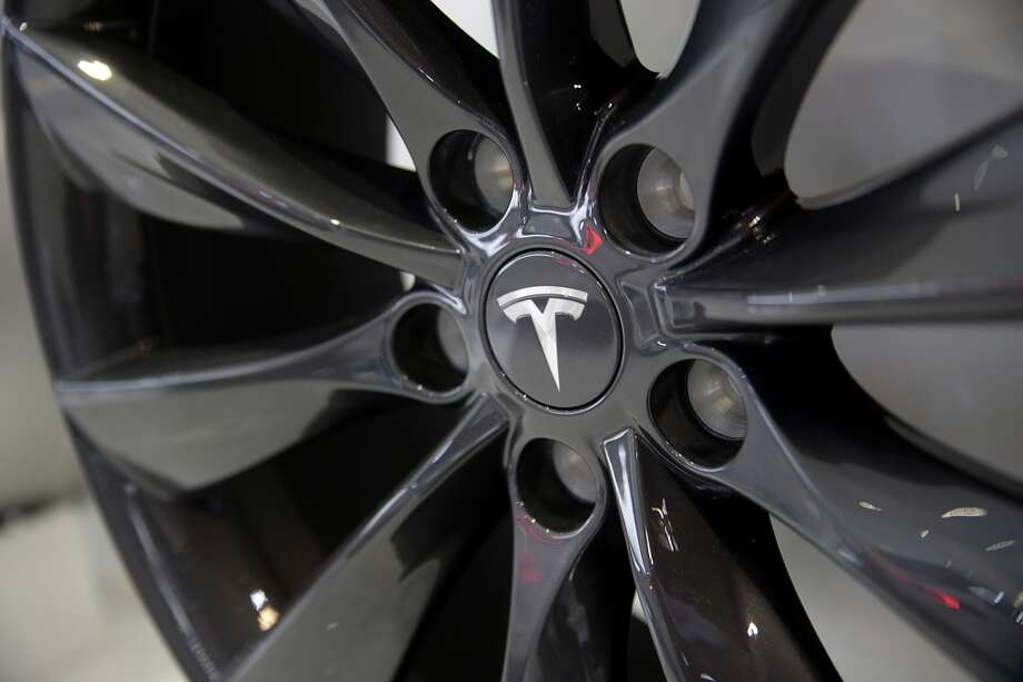 The Tesla Motors Inc. logo is seen on the hubcap of a Model S sedan at the company's booth during the 2014 North American International Auto Show (NAIAS) in Detroit, Michigan, U.S., on Tuesday, Jan. 14, 2014. Tesla Motors Inc., the maker of high-end electric cars, gained the most in six weeks after the carmaker said it delivered 6,900 Model S sedans in the fourth quarter, pushing full-year sales beyond a company target. Photo: Andrew Harrer, Bloomberg