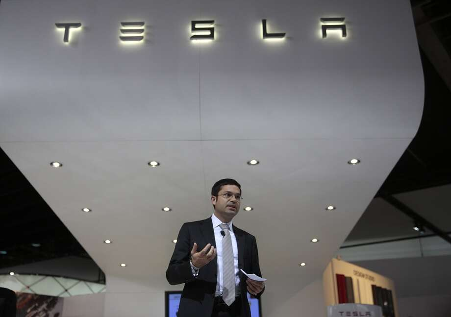 Jerome Guillen, vice president of worldwide sales and service for Tesla Motors Inc., speaks during the 2014 North American International Auto Show (NAIAS) in Detroit, Michigan, U.S., on Tuesday, Jan. 14, 2014. Tesla Motors Inc., the maker of high-end electric cars, gained the most in six weeks after the carmaker said it delivered 6,900 Model S sedans in the fourth quarter, pushing full-year sales beyond a company target. Photo: Andrew Harrer, Bloomberg