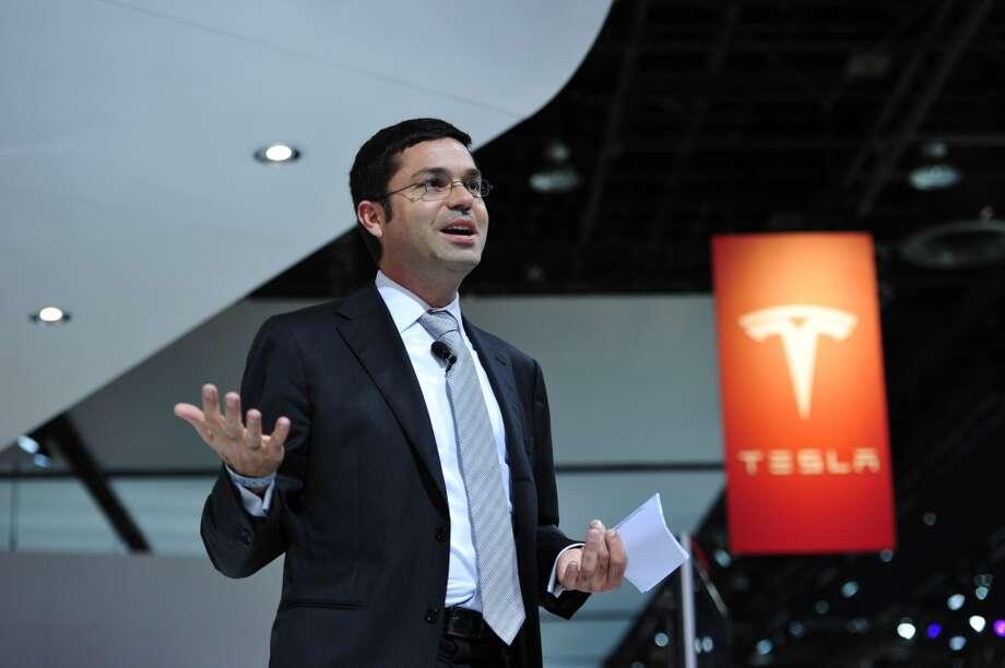 Tesla Vice President for World Wide Sales and Service Jerome Guillen introduces the P85+ all electric car and its charging station at the North American International Auto Show on January 14, 2014 in Detroit. Photo: STAN HONDA, AFP/Getty Images