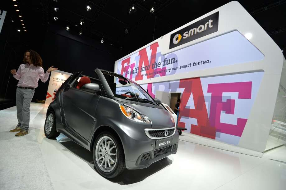 The Smart Cabriolet-ED all electric vehicle on display during the press preview at the North American International Auto Show January 14, 2014 in Detroit. Photo: STAN HONDA, AFP/Getty Images