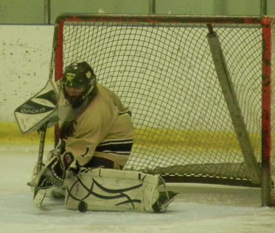 Notre Dame-Fairfield senior goaltender Brooke Bonetti making one of her 38 saves on Wednesday, Jan. 22 at the Milford Ice Pavilion in a 0-0 tie against the Fairfield co-op. Photo: Reid L. Walmark / Fairfield Citizen