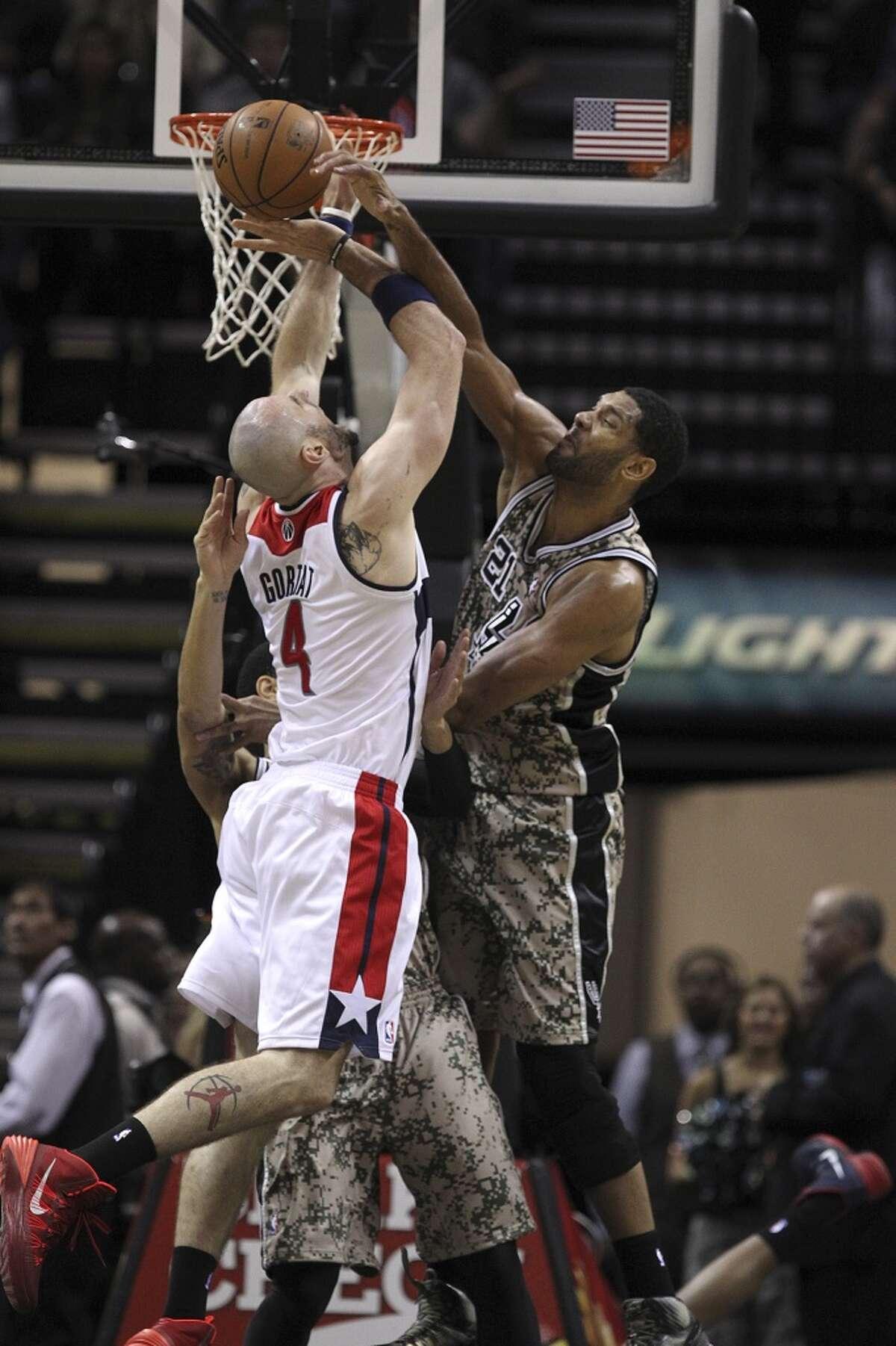 Nov. 13, 2013: Spurs 92, Wizards 79San Antonio Spurs' Tim Duncan fouls Washington Wizards' Marcin Gortat during the first half at the AT&T Center, Wednesday, Nov. 13, 2013.
