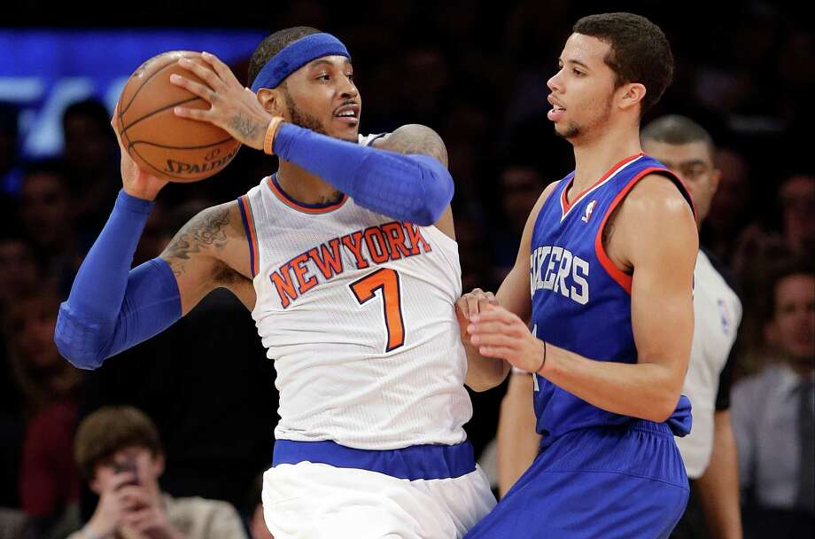New York Knicks' Carmelo Anthony (7) is defended by Philadelphia 76ers' Michael Carter-Williams (1) during the second half of an NBA basketball game Wednesday, Jan. 22, 2014, in New York. The 76ers won the game 110-106. (AP Photo/Frank Franklin II) ORG XMIT: MSG119 Photo: Frank Franklin II / AP