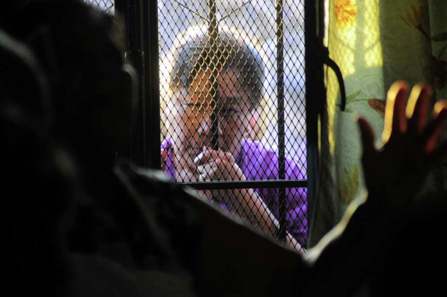 An unidentified person stands at the entrance to the home of the parents of Texas death-row inmate Edgar Tamayo in Miacatlan, Mexico, Wednesday, Jan. 22, 2014. The Mexican national was executed Wednesday night in Texas for killing a Houston police officer, despite pleas and diplomatic pressure from the Mexican government and the U.S. State Department to halt the punishment. Tamayo, 46, received a lethal injection for the January 1994 fatal shooting of Officer Guy Gaddis, 24. Photo: Tony Rivera, Associated Press / Associated Press