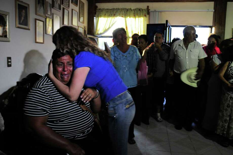 "Edelmira Arias is comforted while weeping at the home of the parents of Texas death-row inmate Edgar Tamayo, her cousin,  in Miacatlan, Mexico, Wednesday, Jan. 22, 2014.  The U.S. Supreme Court rejected appeals Wednesday night for Mexican national Edgar Tamayo, clearing the way for the Texas death row inmate to be executed for the slaying of a Houston police officer 20 years ago. Secretary of State John Kerry previously asked Texas to delay Tamayo's punishment, saying it ""could impact the way American citizens are treated in other countries."" The State Department repeated that stance Wednesday. Photo: Tony Rivera, Associated Press / Associated Press"