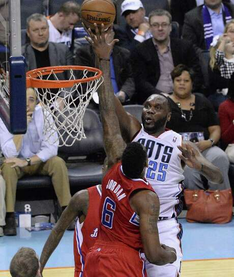 Bobcats big man Al Jefferson (right), shooting over Texas A&M product DeAndre Jordan of the Clippers, had a double-double in Wednesday's win. Photo: Robert Lahser / Charlotte Observer / Charlotte Observer
