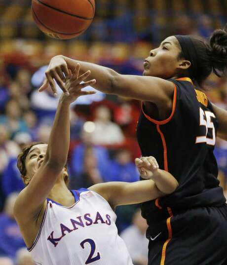 Oklahoma State's LaShawn Jones (right) blocks a shot by Kansas' Dakota Gonzalez in a 64-56 win. Photo: Orlin Wagner / Associated Press / AP