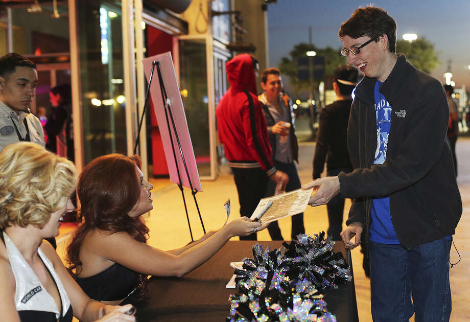 Bandera High senior Milam Boyle, getting autographs from the Silver Dancers before the Spurs game, made a shot at the buzzer in a Bulldogs game the previous night that led to a social media campaign to get the basket on ESPN's SportsCenter. Photo: Jerry Lara / San Antonio Express-News / ©2013 San Antonio Express-News