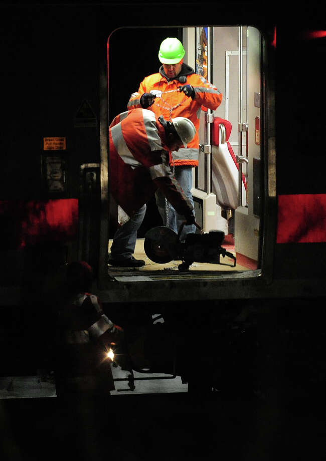 January 2014: Metro North workers repair a train that was stranded near the Green Farms station in Westport, Conn. on Wednesday January 22, 2014. As many as 200 passengers were stuck in the train with no heat since 9 pm. They were all safely transferred to another train within two hours. Photo: Christian Abraham / Connecticut Post