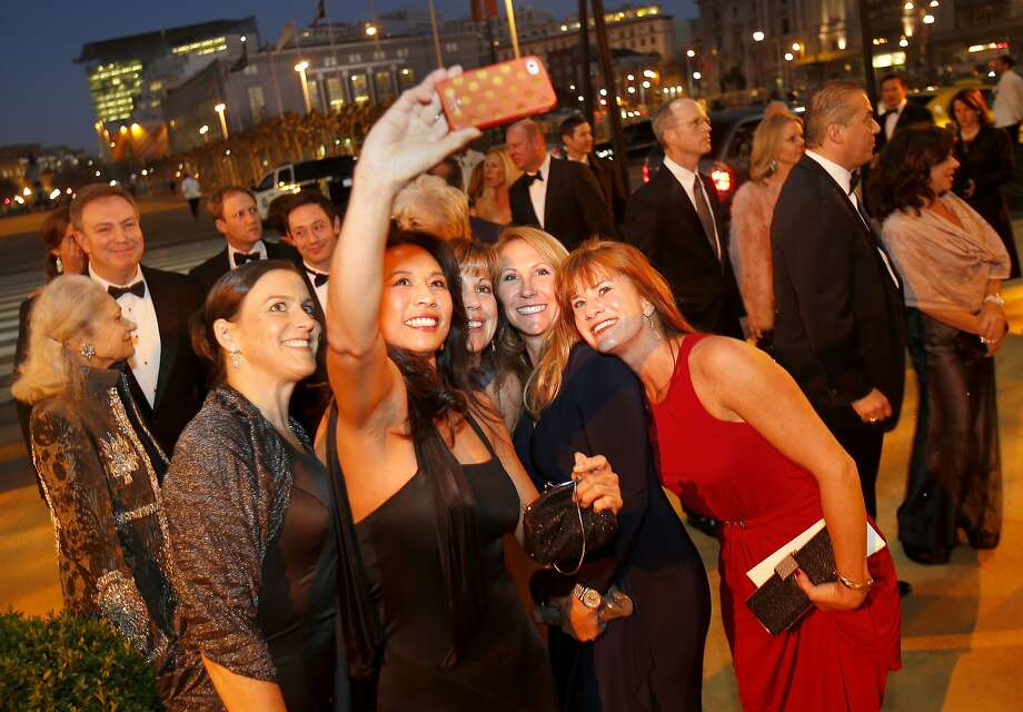 """While waiting in line, a group of guests made their own picture. The San Francisco ballet season opening gala with a theme of """"Phenomenal"""" at City Hall Wednesday January 22, 2014 featured a dinner in the rotunda, and cocktails in the South Light Court. Photo: Brant Ward, The Chronicle"""