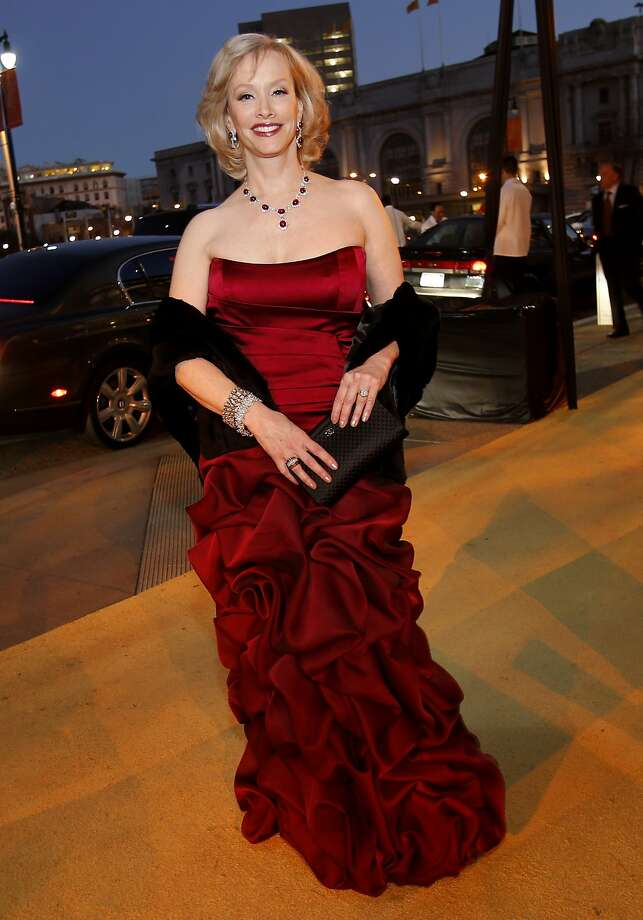 O.J. Shansby wears a claret-colored Robert Danes couture gown. An elegant ruby necklace accents the rich-toned sleeveless dress. Photo: Brant Ward, The Chronicle