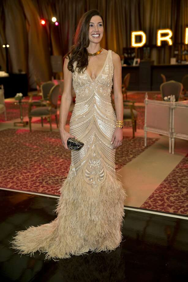 Sarah Somberg in a Naeem Khan gown accessorized with a Venetian mask-inspired Judith Leiber clutch. Somberg had seen Beyonce wear the same gown and decided to try it on for size. The fit was perfect. Photo: Laura Morton, Special To The Chronicle