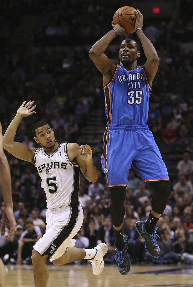 Kevin Durant has a clear look at a 3-pointer as Spurs guard Cory Joseph tries to defend at the AT&T Center. Durant scored 36 but also had 11 turnovers. Photo: Jerry Lara / / ©2013 San Antonio Express-News