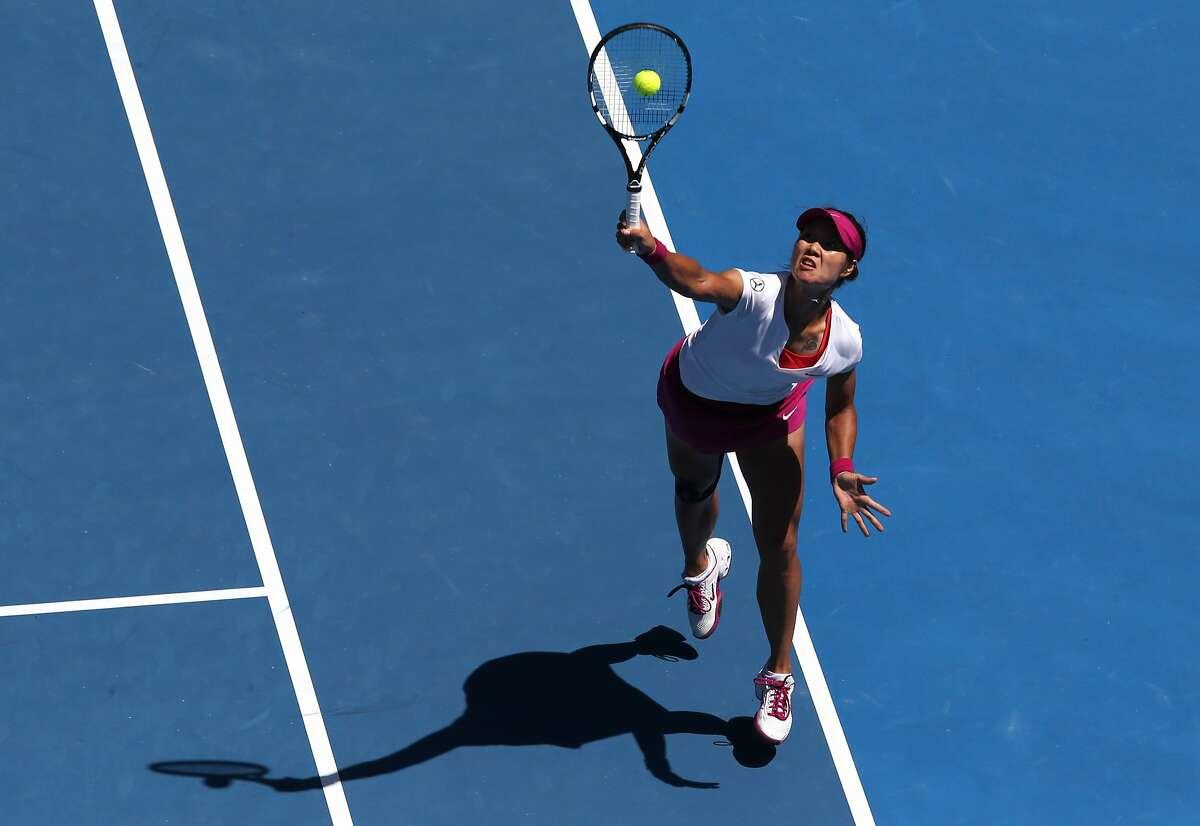 Li Na of China plays a shot to Eugenie Bouchard of Canada during their semifinal at the Australian Open tennis championship in Melbourne, Australia, Thursday, Jan. 23, 2014.(AP Photo/Eugene Hoshiko)