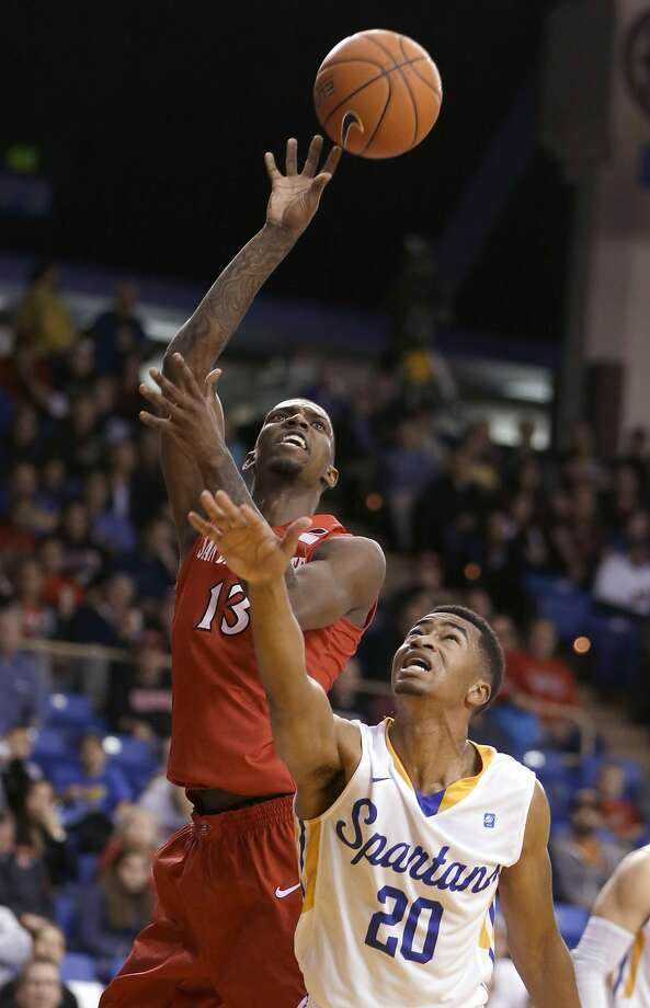 Winston Shepard, who had 12 points and nine rebounds, shoots over Isaac Thornton. Photo: Ben Margot, Associated Press