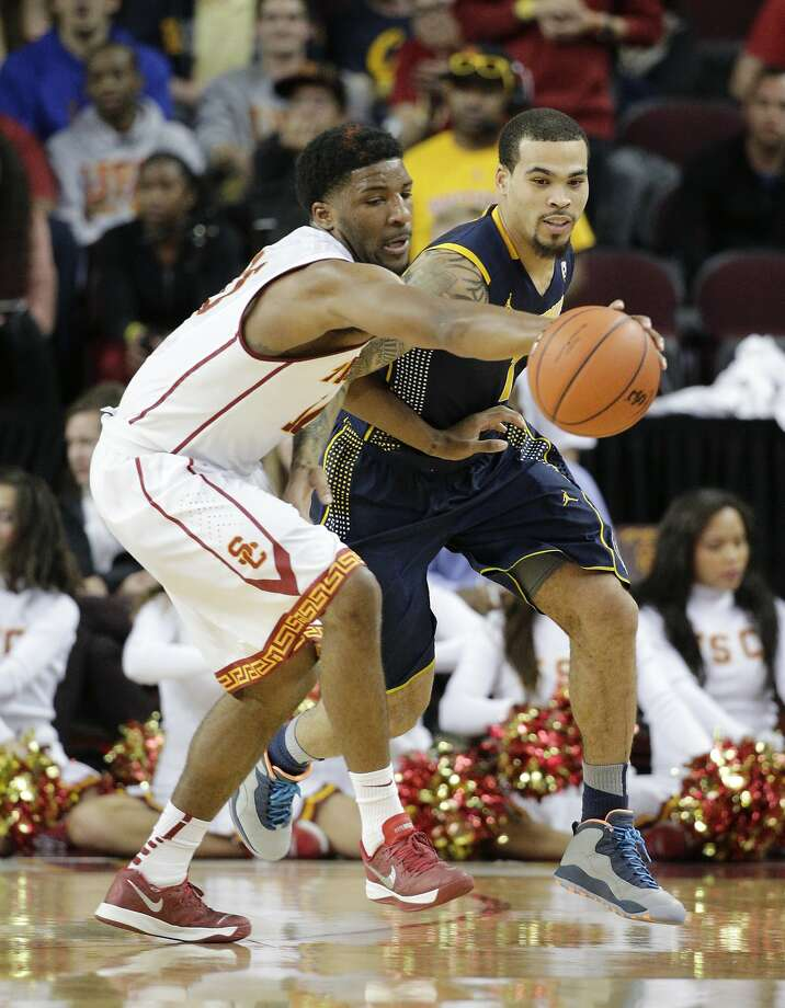 USC's Pe'Shon Howard (left) swipes the ball from Cal's Justin Cobbs. Photo: Jae C. Hong, Associated Press