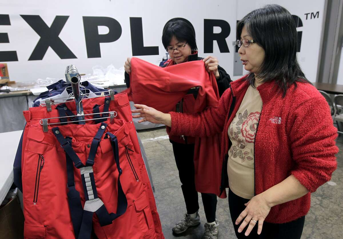 Seamstress Betty Beh (left) and supervisor Lydia Lam inspect outerwear at the North Face development center in San Leandro.