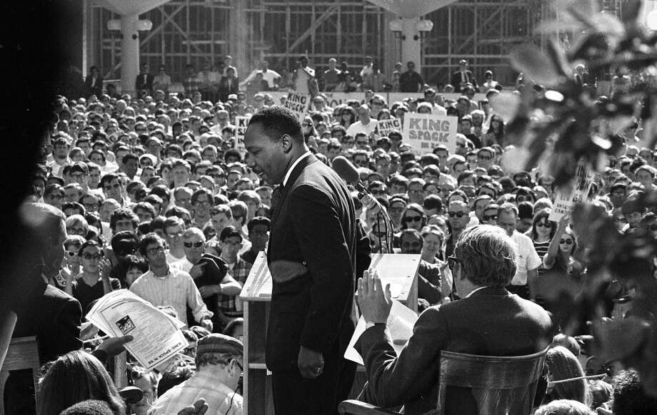 "King gets ready to speak. Both the fliers in the hand of the man on the left, and signs in the crowd, pushed for ""King/Spock in '68."" They're referring to a possible presidential ticket with Dr. Benjamin Spock. Photo: Art Frisch, The Chronicle"