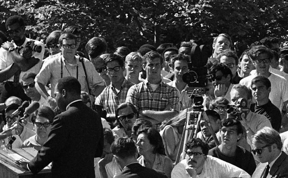 Another view of the students standing to the right of Dr. King. Note all the cameras and camera straps. I think I see a student with an 8mm camera behind the larger newsreel camera. Photo: Art Frisch, The Chronicle