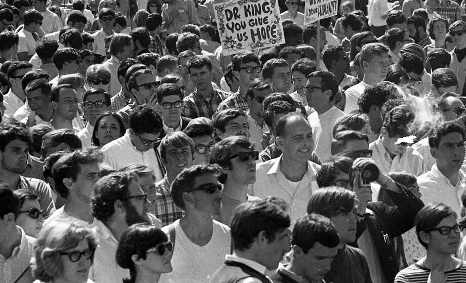 Frisch took the time to photograph some students near the back of the plaza, with some homemade signs. Photo: Art Frisch, The Chronicle