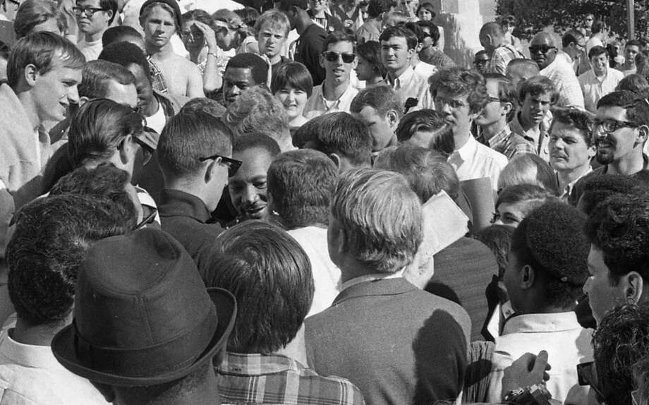 One of two photos showing a happy-looking King walking through the crowd after his speech. You can see his head on the middle/left. Photo: Art Frisch, The Chronicle