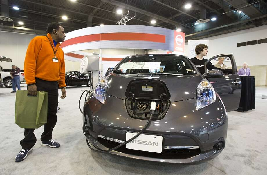 Keith Mack of Stafford, who is considering buying an electric car, inspects the LEAF. Photo: Thomas B. Shea, Houston Chroncile