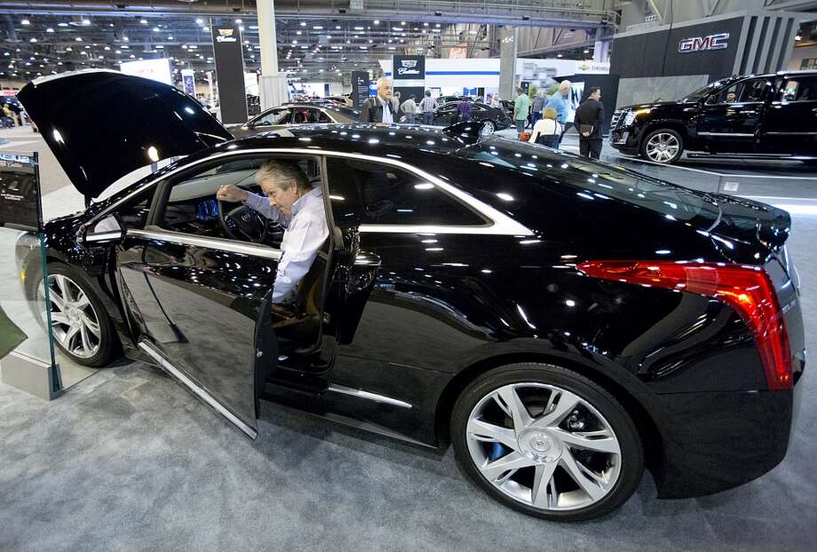 Judge Don Coffey steps into  the electric Cadillac. The car lists for $75,000. Photo: Thomas B. Shea, Houston Chroncile