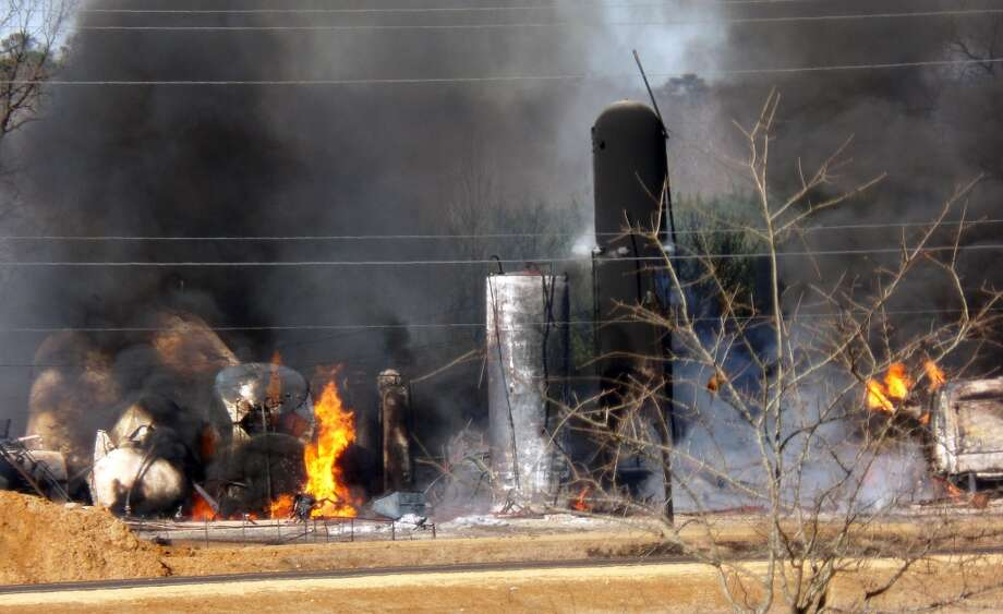 A fire at a biodiesel facility near New Albany, Miss., burns Wednesday, Jan. 22, 2014.  The fire was so hot that firefighters could not get close enough to fight it, the Mississippi Highway Patrol said. Photo: Angie Barmer, ASSOCIATED PRESS