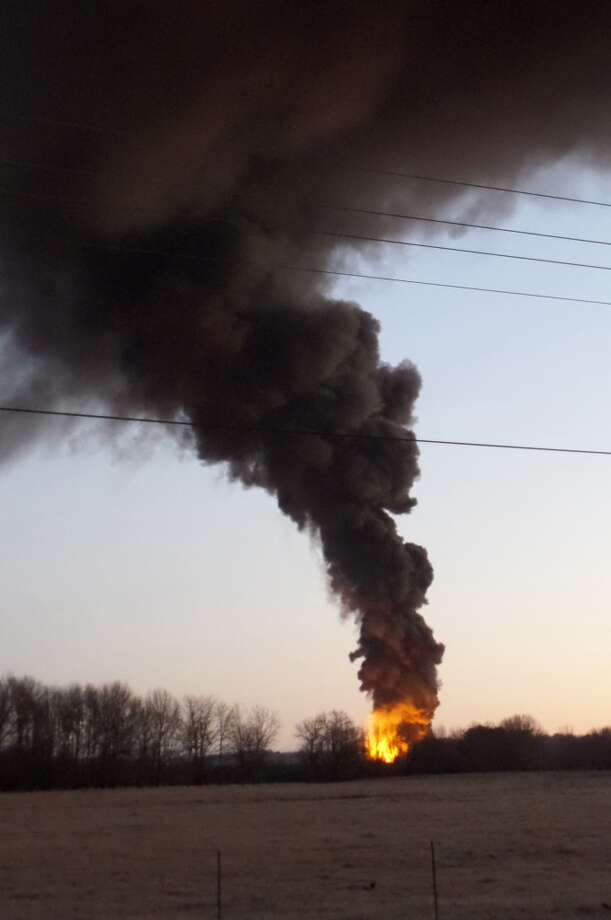 A fire at a biodiesel facility near New Albany, Miss., burns early Wednesday, Jan. 22, 2014.  The fire was so hot that firefighters could not get close enough to fight it, the Mississippi Highway Patrol said. Photo: Angie Barmer, AP